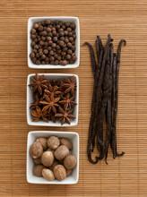 Overhead Shot Of Spices: Allspice, Anise Star, Nutmeg & Vanilla