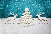 Winter Craft, Two Deers Around A Pine Tree With Glitter Background