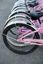A Row Of Pink Bicycles