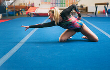 Gymnastics: Teen Female Stops To Pose During Floor Routine