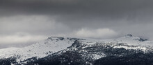 Panorama Landscape Of A Snowy Mountain With Storm
