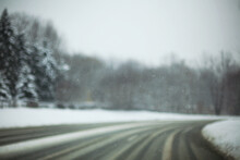 A Curved Road Covered With Sno...