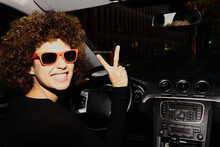 Afro Young Woman In Sunglasses Driving A Car