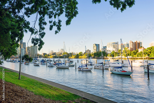Brisbane River with boats moored in the foreground, looking to the city and Storey Bridge - 375006174