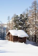 Wooden Hut In The Snowy Landscape