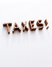 Taxes Spelled In Stacks Of Pennies