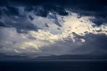 Turbulent Sky Over The Sea