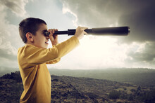 Child With Spyglass Looks Far For A New Adventure