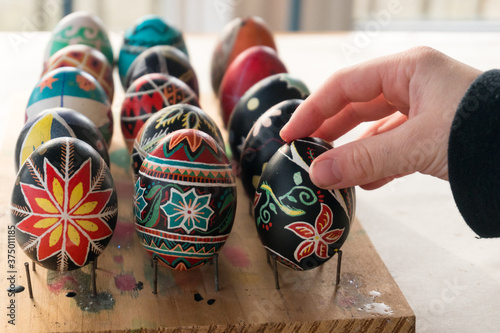 Canvas Print Colorful Ukrainian Easter eggs placed on homemade drying rack