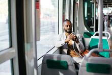 Black Passenger Using Smartpho...