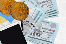 5 Egyptian Pounds Bills And Golden Bitcoins With Smartphone And Credit Cards. Cryptocurrency Investment Concept. Crypto Mining Or Trading