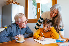 Grandparents Helping Boy With ...