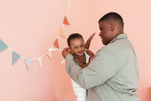 Black Father Dressing Cute Baby