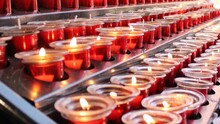Red Prayer Candles Flame At Ch...