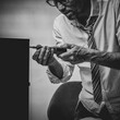 Black and white photo of Unqualified tired office worker repairing broken computer