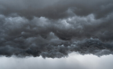 Dramatic dark grey clouds sky with thunder storm and rain. Abstract nature landscape background.