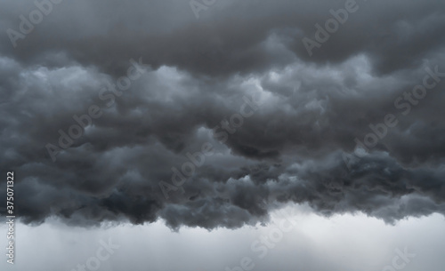 Fotografia, Obraz Dramatic dark grey clouds sky with thunder storm and rain