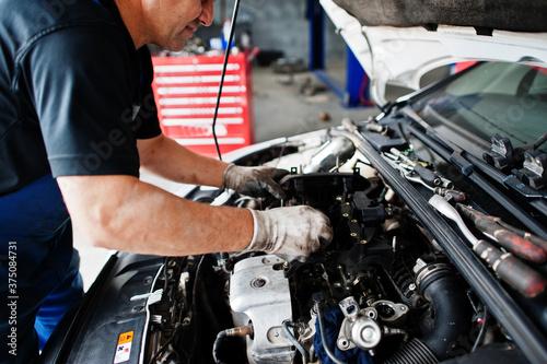 Fototapeta Car repair and maintenance theme