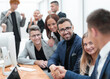 business people shaking hands sitting at the office Desk.