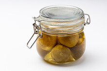 Pickled Limes In A Glass Bottle On White Background , Concept Of Keeping Food Stored For A Long Time