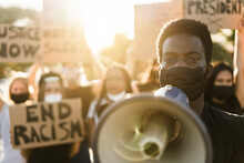 People From Different Culture And Races Protest On The Street For Equal Rights - Demonstrators Wearing Face Masks During Black Lives Matter No Racism Campaign - Focus On Black Man Eyes