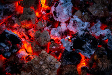 Burning Coals. Close-up Of Dec...