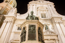Loreto, Marche, Province Of Ancona. View Of The Monument To Pope Sixtus V, The Blessing Of The Bronze Statue From The Chair And The Basilica Of Santa Casa At Night. Popular Place Of Pilgrimage For
