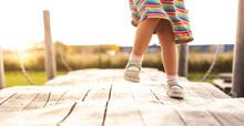 Child Exercises Balance On Une...
