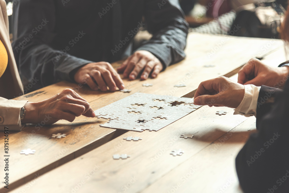Fototapeta Implement improve puzzel solve connections together with synergy strategy team building organizing connection by trust communication. Hands of stakeholders business trust team holding jigsaw puzzle