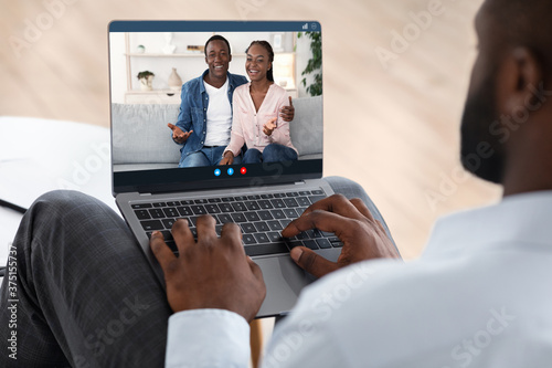 Fototapeta Marriage Therapy Online. Counselor speaking with couple via video call on laptop obraz na płótnie