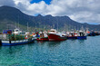 canvas print picture - Moored fishing boots in the small fishing village of Hout Bay in Western Cape, South Africa
