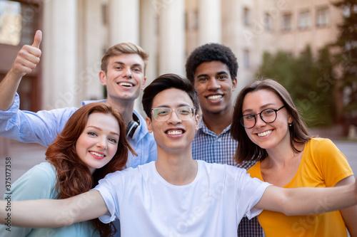 Valokuvatapetti Cheerful Multicultural Students Posing Together Making Selfie Near University Bu