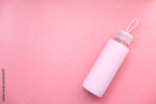 top view sport bottle isolated on pink background