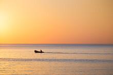Sunrise With Lone Fisherman