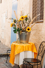 A Bouquet Of Sunflowers In A B...