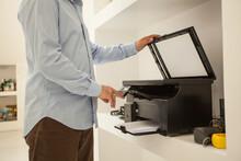 Anonymous Man Using Printer