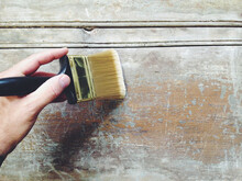 Paint Brushes On A Wooden Board