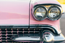 Close Up Of Antique Pink And Chrome Car
