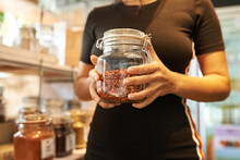 Zero Waste Food Shopping. Hands With Grocery Products In Reusable Glass Jars. Woman Buying Bulk Dry Goods In Sustainable Plastic Free Store. Eco-friendly Low Waste Concept. Minimalist Lifestyle