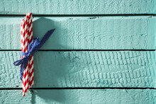 Bunch Of Striped Straws On A Blue Wooden Board