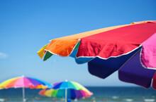 A Trio Of Colorful Beach Umbrellas