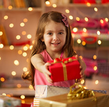 Child Surrounded With Christmas Presents