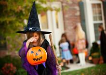 Halloween: Girl Looking Into Candy Bucket