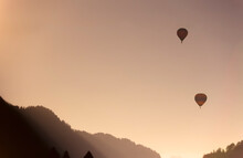 Hot Air Balloon Flying In The Mountains