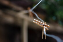 Wood Clothespins On A Wire