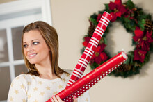 Christmas: Holding Wrapping Paper Rolls