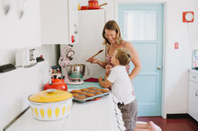 Mother Baking With Son In Cute...