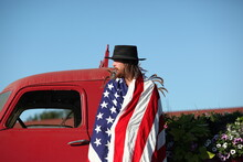 Portrait OF A Man Wrapped In A American Flag