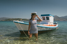 Attractive Girl In Front Of Small Boat In The Sea