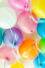 Bunch Of Floating Mixed Colored Balloons And Strings